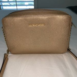 Michael Kors gold purse w/ gold metal